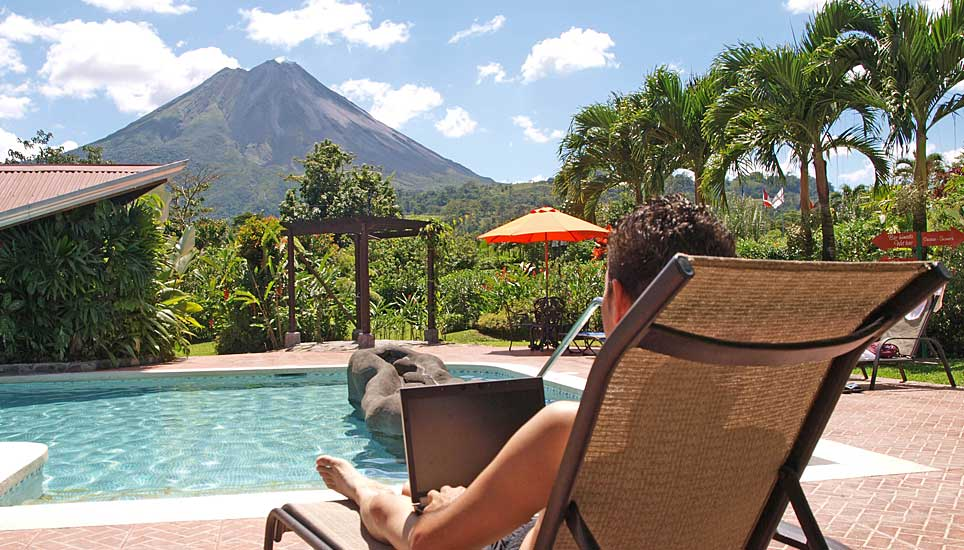 Arenal Springs pool and view of volcano