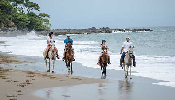 Horse riding along the beach at Tango Mar