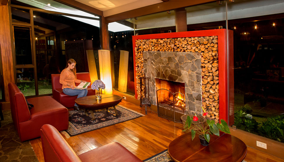 Relax by the fire at Chayote Lodge