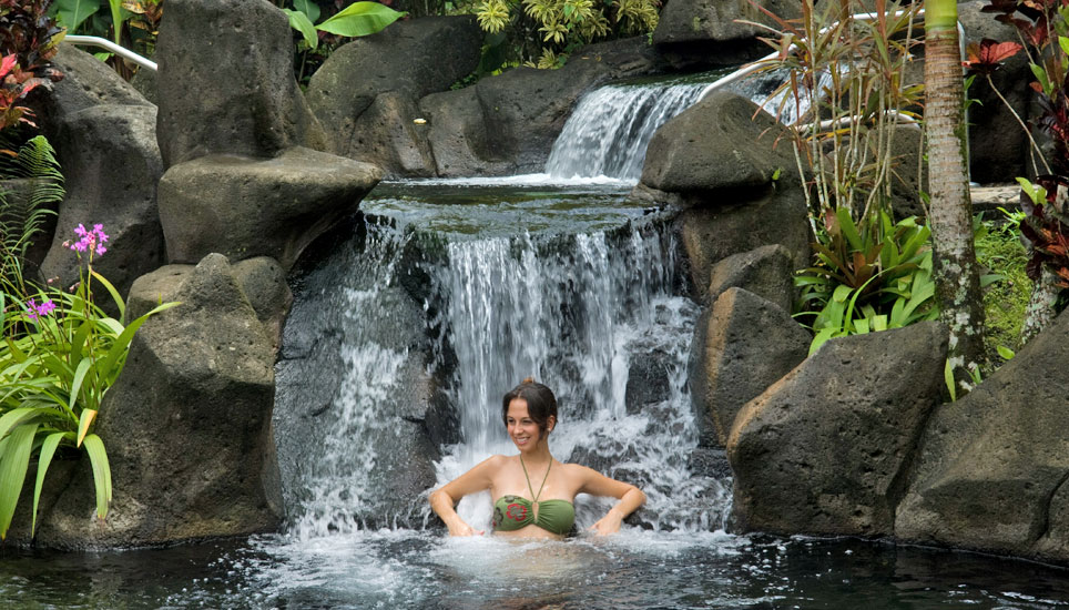 Person enjoying Hot springs at Arenal Kioro